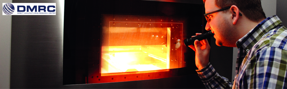 Quality control during a Laser Sinter (LS) build job by a researcher of the DMRC.