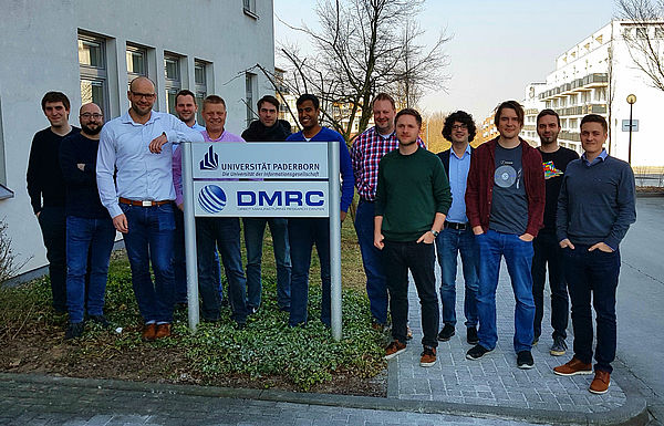 Participants and speakers of the seminar in front of the DMRC